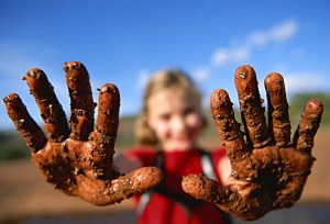 getty_rm_photo_of_girl_with_mud_caked_hands